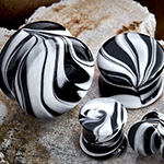 Double flare Borostone plugs (black/white)