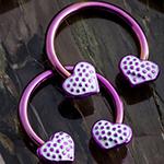 Purple circular barbell with purple polka dot hearts