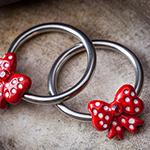 Red polka dot bow captive