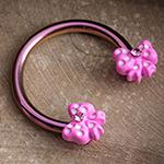 Pink circular barbell with pink bows