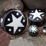 Black horn plugs with star and dot inlays