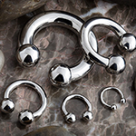 Internally threaded titanium circular barbell
