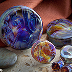 Double flare Borostone plugs (amber/purple)