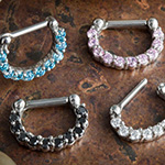 Steel clicker with prong set gems