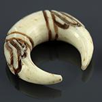 Bone ornate pincher