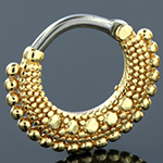 Gold colored ornate septum clicker