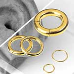 Gold colored clicker ring