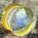 Double flare dichroic foil plugs (Purple foil on translucent yellow)
