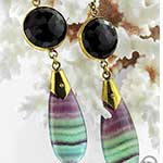 Solid brass with faceted black agate and fluorite weights