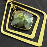 Solid brass and faceted labradorite movement weights