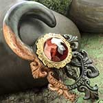 Ebony wood Tears of Gaia with brass and faceted red tiger eye