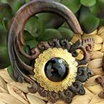 Ebony wood Oceanus with brass and faceted black agate