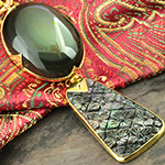 Solid brass and rainbow obsidian with black mother of pearl weights