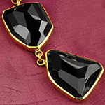 Solid brass and faceted obsidian weights