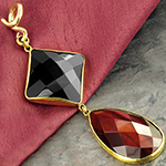 Solid brass with black agate and red tiger eye weights
