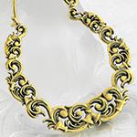 Brass ornate swirl hoops