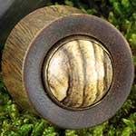 Lignum vitae plugs with picture jasper inlays