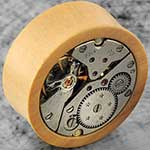 Boxwood plugs with watch movement inlays