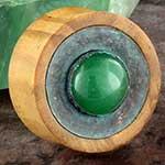 Olivewood plugs with green aventurine inlays