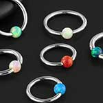 Steel opal captive bead ring
