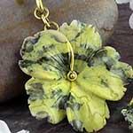 Solid brass and serpentine flower weights