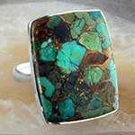 Silver and bronze boulder turquoise ring