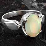 Silver and faceted opal ring