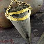 Solid brass and megalodon teeth saddle weights