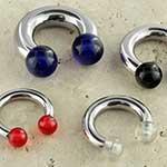 Steel internally threaded circular barbell with acrylic balls