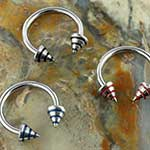 Steel circular barbell with striped cones