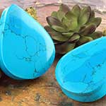 Synthetic turquoise teardrop plugs